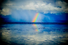 Rainbow over the ocean. rays rest, new zealand Royalty Free Stock Photo