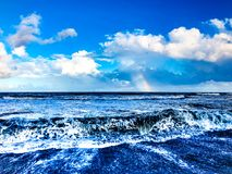 Rainbow over the ocean after a storm Royalty Free Stock Photo