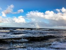 Rainbow over the ocean after a storm Stock Photo