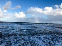 Rainbow over the ocean after a storm Royalty Free Stock Images