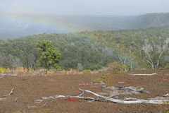 Rainbow over the old lava field trail in Volcanoes National Park, Big Island of Hawaii Stock Images