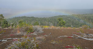 Rainbow over the old lava field trail in Volcanoes National Park, Big Island of Hawaii. USA Stock Photo