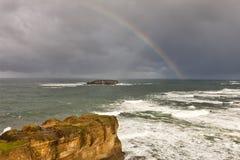 Rainbow over the Pacific. Stock Photo