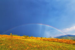 Rainbow over panoramic landscape. Beautiful rainbow over panoramic landscape Royalty Free Stock Photos
