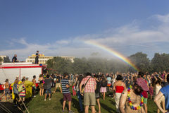 Rainbow over the people attending the Prague Pride Stock Photography