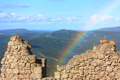 Rainbow over Peyrepertuse. Rainbow over the walls of the old castle Peyrepertuse, Aude, France Royalty Free Stock Image