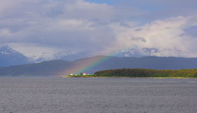Rainbow over Point Retreat Lighthouse stock image
