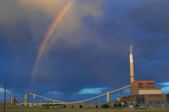 Rainbow over a power plant Stock Image