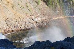 Rainbow over a powerful flow of water under the waterfall of the river Urich in the Eastern Sayan Stock Photo