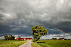 Rainbow over railroad with train royalty free stock images