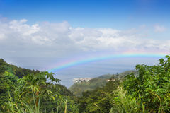Rainbow over the rain-forest at Island Dominican Republic. Stock Image