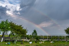 rainbow over rapeseed field royalty free stock images