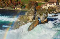 Rainbow over the Rhine Falls waterfall in Switzerland. Laufen, Switzerland - 17 October, 2017: a rainbow over the Rhine Falls, view from the Laufen castle. The Stock Photo