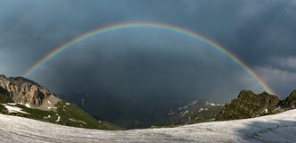 Rainbow over ridge Abushura Akhuba in the wake of a storm. Stock Photo
