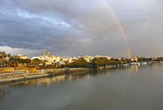 Rainbow over the River Guadalquivir as it passes through Seville, Spain Stock Images