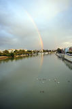 Rainbow over the River Guadalquivir in Seville, Spain. Panoramic view of the famous river Guadalquivir that crosses the city of Seville with the Tower of Gold in stock image
