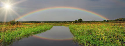 Rainbow over the river Stock Photography