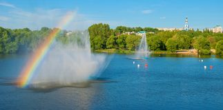 Rainbow over river Stock Images