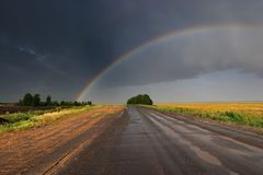 Rainbow over road Royalty Free Stock Photo