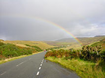 Rainbow over the road Royalty Free Stock Photo