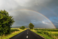 Rainbow over road Royalty Free Stock Image