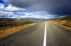 Rainbow over the road Royalty Free Stock Images