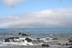 Rainbow over Rocks Stock Photos
