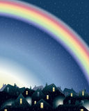 Rainbow over rooftops Stock Photography