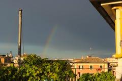 A rainbow over an Italian city on an overcast day stock photography