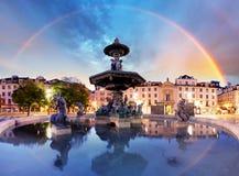 Rainbow over  Rossio square in Lisbon Portugal Stock Image