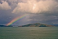 Rainbow over San Francisco Bay. Looking east from the Golden Gate Bridge Royalty Free Stock Images