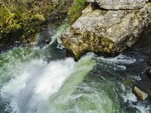 Rainbow over saut du doubs waterfall in the region of doubs stock photography