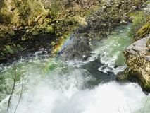 Rainbow over saut du doubs waterfall in the region of doubs royalty free stock photo