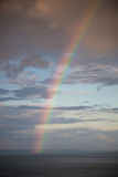 Rainbow over the sea Stock Photography