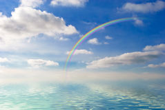 Rainbow over sea Stock Images