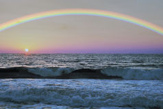 Rainbow over the sea. At sunset stock images
