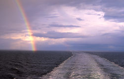 Rainbow over sea. A view of a rainbow over the sea Stock Photography