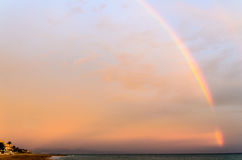 Rainbow over the sea. This beautiful rainbow appeared in Spain Stock Photo