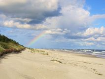 Rainbow over the sea Stock Image