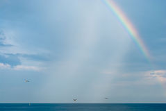 Rainbow over sea Stock Photos