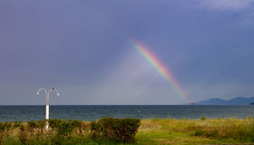 A rainbow over sea Stock Photos