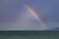 A rainbow over sea Stock Photo