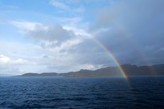 Rainbow over the sea Royalty Free Stock Image
