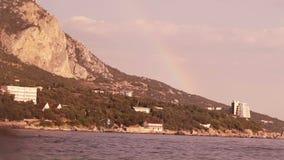 Rainbow over sea shore Royalty Free Stock Photo