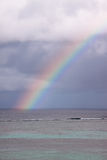 Rainbow over the sea. Royalty Free Stock Image