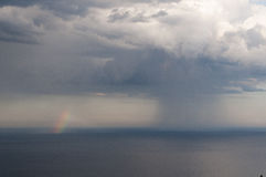 Rainbow over sea water Royalty Free Stock Image