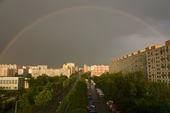 Rainbow over settlement Stock Images