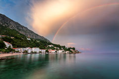 Rainbow over the Small Village in Omis Riviera after the Rain Stock Photography