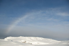 Rainbow over snow-covered Antarctic islands. Stock Images