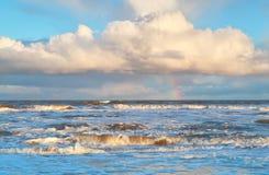 Rainbow over stormy North sea Stock Image